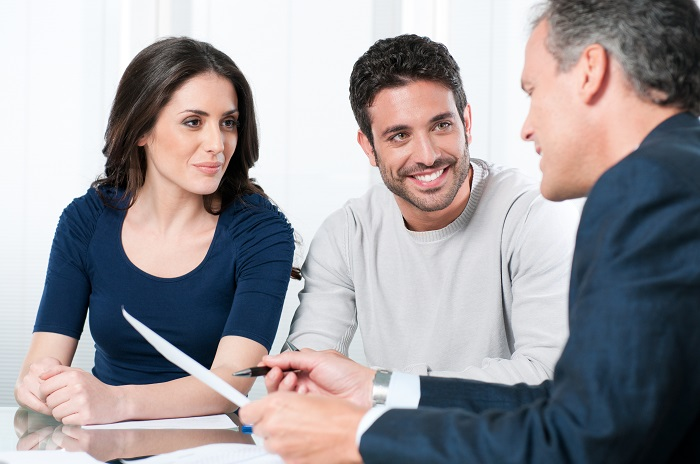 Businessman Consulting With Couple